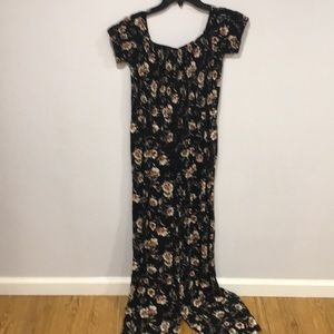 Black floral smocked off the shoulder jumpsuit. M.
